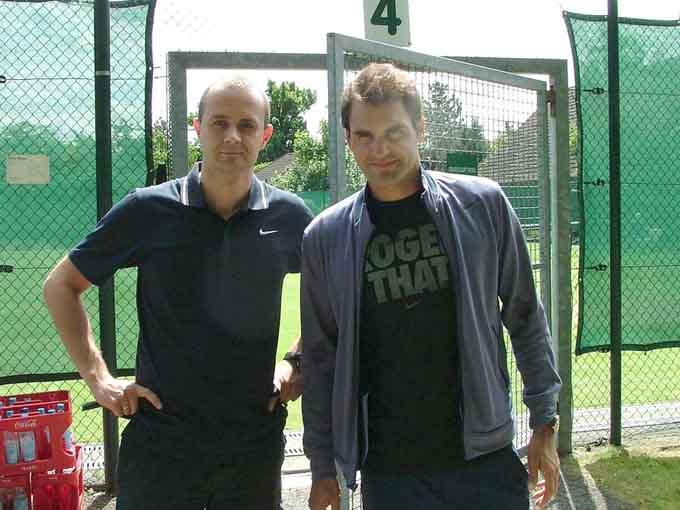 Z Rogerem Federerem na turnieju w Halle, 2013 r.